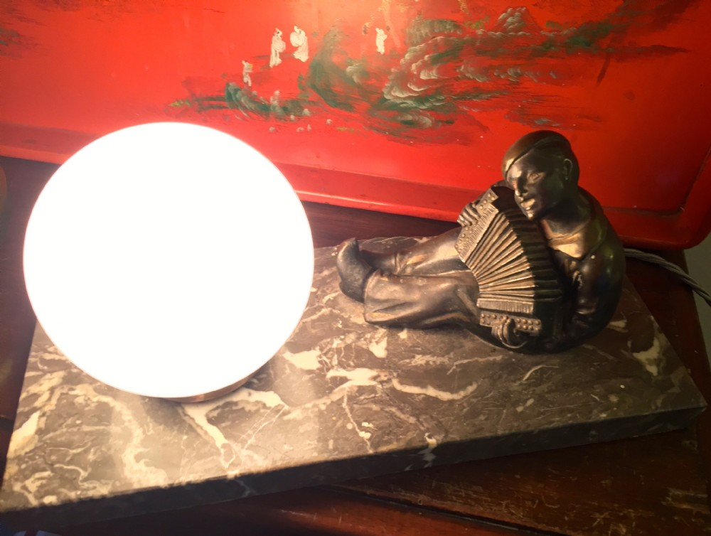 evocative night light pierrot playing accordion spelter on marble